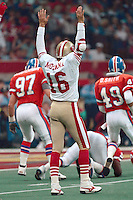 NEW ORLEANS, LA - Quarterback Joe Montana of the San Francisco 49ers signals for a touchdown during Super Bowl XXIV against the Denver Broncos at the Superdome in New Orleans, Louisiana in January of 1990. Photo by Brad Mangin.