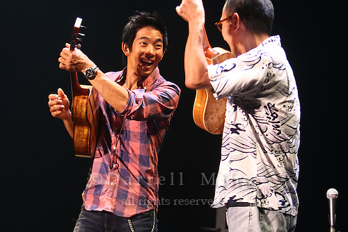 "Aug. 17, 2010 ; Kanazawa, JPN - Sound check with guest ukulele player Ken Kawai. Jake Shimabukuro at the Hokkoku Shimbun Akabane Hall during the ""I Love Ukulele Tour 2010""."