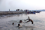 Boy play in the Ganga, Varanasi These images were made as part of a personal project on the handloom weavers in Varanasi. In these, I focused on the education of the weaver's children.I am grateful to the help I received from the People's Vigilance Committee on Human Rights (PVCHR).