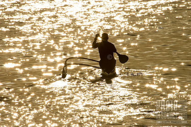 A paddler strikes out from Kailua Beach for a morning on the ocean