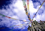 Banners stretch to the tip of a local Cathedral outside Xela, Guatemala.