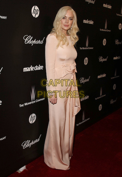 Lindsay Lohan.The Weinstein Company 2012 Golden Globe Awards After Party held at  Bar 210 at the Beverly Hilton Hotel, Hollywood, California, USA..January 15th, 2012.globes full length pink cream dress bow sash long sleeves .CAP/ADM/CH.©Charles Harris/AdMedia/Capital Pictures