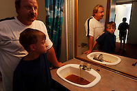 Kenny Stroud and sons Chase and Aaron react to the orange/black water in the bathroom that smells and has an oily residue mixed with coal soot. <br /> <br /> Kenny's health is affected and he fears for his sons. Kenny reacts with rashes and red eyes when he showers. He tells the kids &quot;Don't brush teeth in water. Don't drink the water.&quot; <br /> <br /> When he moved in six years ago he thought the only problem was that the water was discolored by iron. Stroud, 38, developed gallstones, breathing problems, memory loss, and his hair is falling out. He has anxiety, nervousness and his pancreas is at two percent function. All of this occurred after he moved to this trailer. Scared for his family, he asks, &quot;What have I done to them?&quot; Neighbors in nearby Williamson and Rawls who have the same water are having it analyzed. <br /> <br /> A November 4, 2003 Associated Press article by Michelle Saxton of the Williamson Daily News entitled &quot;Water in Mingo Communities Contains Manganese&quot; stated that some security guards quit opening valves on Massey pumps when they realized they were poisoning the community. In a later court hearing it was shown that Massey Coal Company had, indeed, Illegally injected slurry from the Rawls Sales Processing Company (Massey Coal Company subsidiary) impoundment into abandoned underground mines for at least eight years.