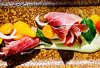 Prosciutto with roasted chilies and cherry tomatoesBlack Cat Restaurant in Boulder, Colorado, August 23, 2018. <br /> <br /> Photo by Matt Nager