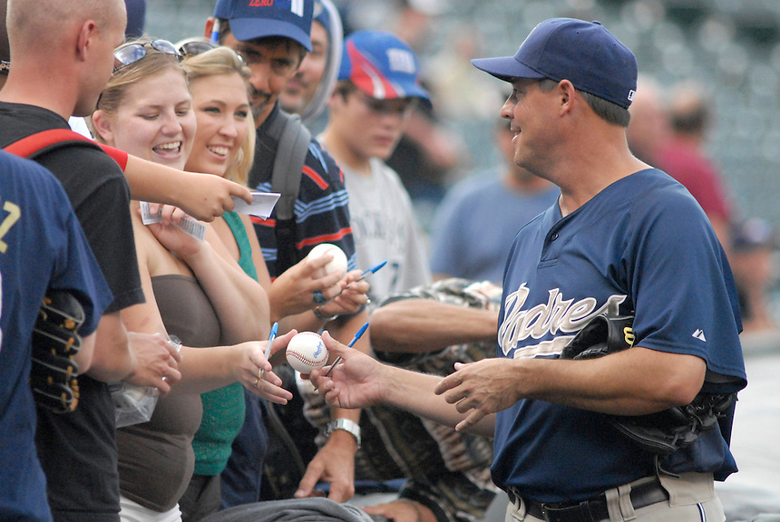08 August 08: San Diego Padres pitcher Greg Maddux signs autographs for fans prior to a game against the Colorado Rockies. The Rockies defeated the Padres 6-3 at Coors Field in Denver, Colorado.