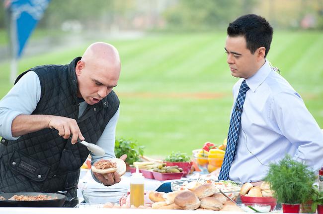 "October  14, 2011 - Bristol, CT - Campus Green: ABC's ""The Chew"" Chef Michael Symon with NASCAR Now's Michael Yam...Credit: Joe Faraoni"