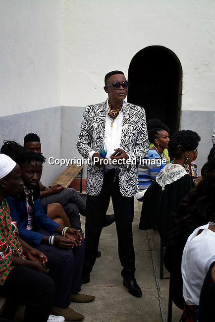 JOHANNESBURG, SOUTH AFRICA – MARCH 7: Invited guests wait for a show with the South African designer David Tlale during the Johannesburg Fashion Week at Constitution Hill, South Africa on March 7, 2015. (Photo by: Per-Anders Pettersson)