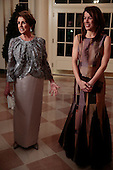 United States House Minority Leader Nancy Pelosi (Democrat of California), left, and Jacqueline Kenneally arrive to a state dinner hosted by U.S. President Barack Obama and U.S. First Lady Michelle Obama in honor of French President Francois Hollande at the White House in Washington, D.C., U.S., on Tuesday, Feb. 11, 2014. Obama and Hollande said the U.S. and France are embarking on a new, elevated level of cooperation as they confront global security threats in Syria and Iran, deal with climate change and expand economic cooperation. <br /> Credit: Andrew Harrer / Pool via CNP