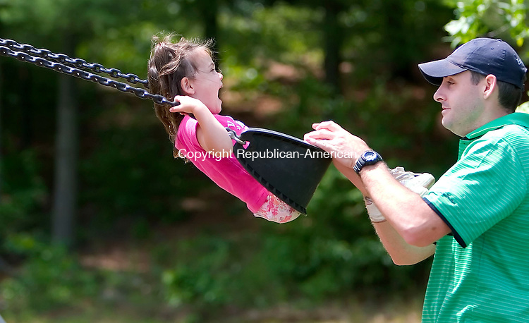 BEACON FALLS, CT- 01 JULY 2007- 070107JT01-<br /> Grace Sizer, 2, screams in delight as her father John Sizer IV gives her a push on a swing on Sunday morning at the Beacon Falls Recreational Complex.<br /> Josalee Thrift Republican-American