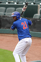 Iowa Cubs outfielder Junior Lake (21) warms up in the on deck circleduring a Pacific Coast League game against the Colorado Springs Sky Sox on May 11th, 2015 at Principal Park in Des Moines, Iowa.  Colorado Springs defeated Iowa 13-7.  (Brad Krause/Four Seam Images)