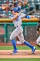 Peter O'Brien (33) of the Omaha Storm Chasers follows through on his swing against the Salt Lake Bees in Pacific Coast League action at Smith's Ballpark on May 8, 2017 in Salt Lake City, Utah. Salt Lake defeated Omaha 5-3. (Stephen Smith/Four Seam Images)