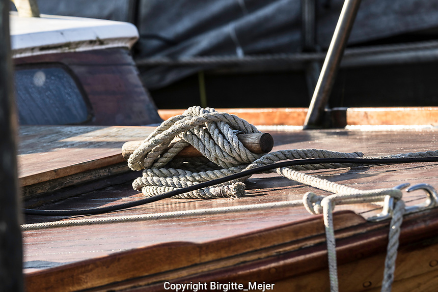 Mooring rope on wooden sail boat photographed up close