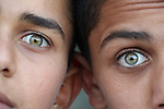 Close up of two boys with green eyes. Photo by Sanad Ltefa