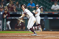 Jake Mangum (15) of the Mississippi State Bulldogs starts down the first base line after bunting the baseball during the game against the Houston Cougars in game six of the 2018 Shriners Hospitals for Children College Classic at Minute Maid Park on March 3, 2018 in Houston, Texas. The Bulldogs defeated the Cougars 3-2 in 12 innings. (Brian Westerholt/Four Seam Images)