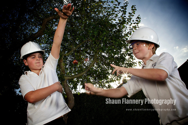 Pix: Shaun Flannery/shaunflanneryphotography.com..COPYRIGHT PICTURE>>SHAUN FLANNERY>01302-570814>>07778315553>>..22nd September 2011....................Two young boy's have a conker fight wearing personal protective equipment in case of injury.