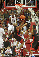 NWA Media/Michael Woods --11/21/2014-- w @NWAMICHAELW...University of Arkansas defender Jacorey Williams goes up to block the shot of  Delaware State's Tyshawn Bell in the second half of Friday nights game against Delaware State at Bud Walton Arena in Fayetteville.