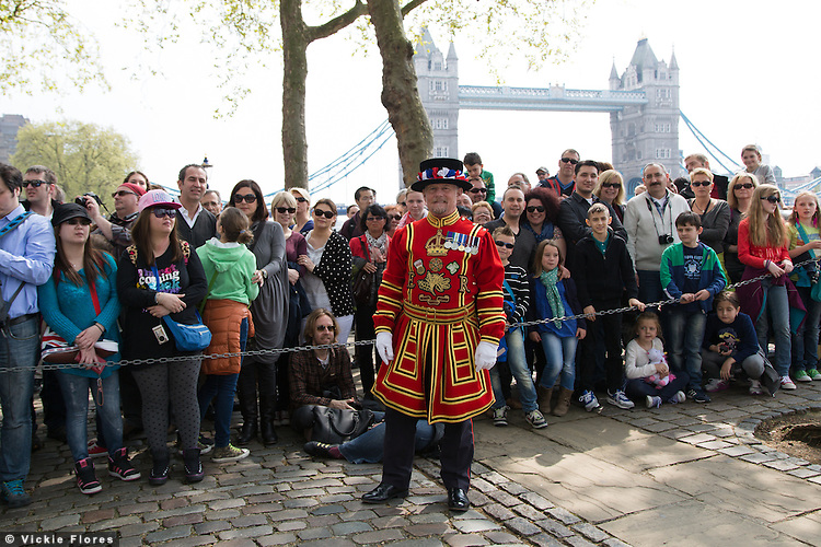 Yeoman Warder, Stephen Froggatt holds back the crowd as a 62 Gun Salute is fired by members of the Honourable Artillery Company (HAC) in honour of Her Majesty the Queen's 88th birthday today, 21st April 2014 at the Tower of London in front of Tower Bridge in London.