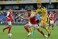 Fleetwood Town's Ched Evans is pressured by Oxford United's Rob Dickie<br /> <br /> Photographer David Shipman/CameraSport<br /> <br /> The EFL Sky Bet League One - Oxford United v Fleetwood Town - Saturday August 11th 2018 - Kassam Stadium - Oxford<br /> <br /> World Copyright &copy; 2018 CameraSport. All rights reserved. 43 Linden Ave. Countesthorpe. Leicester. England. LE8 5PG - Tel: +44 (0) 116 277 4147 - admin@camerasport.com - www.camerasport.com