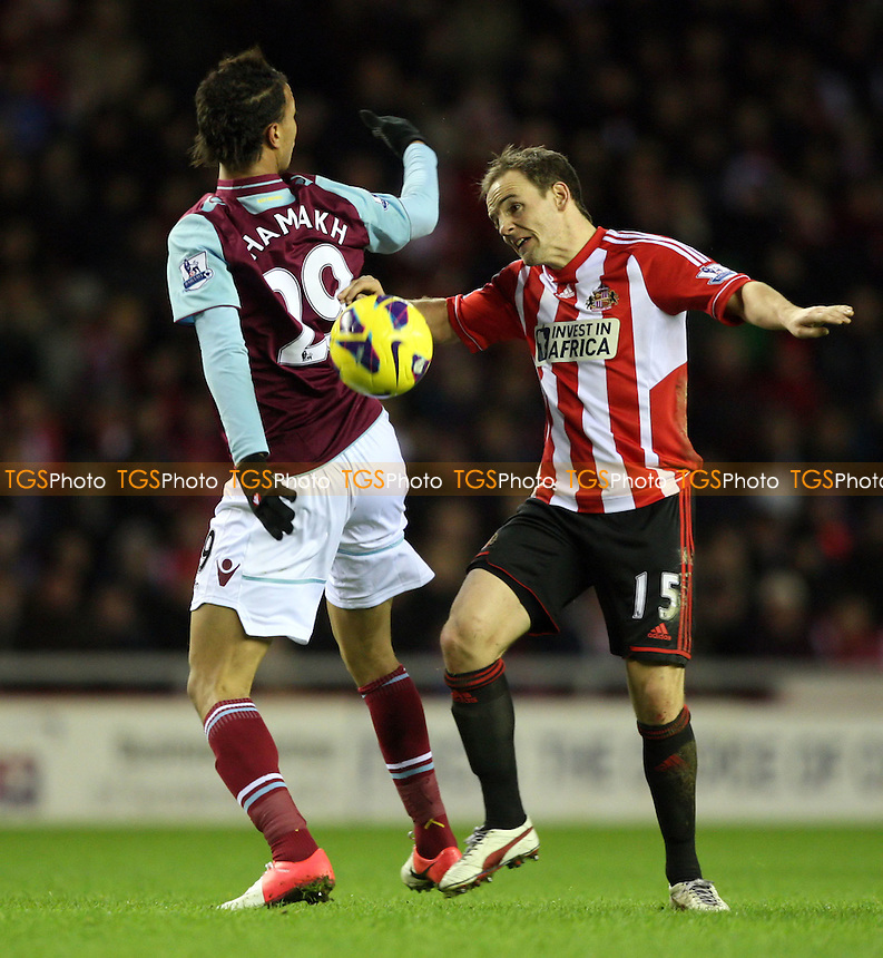 David Vaughan of Sunderland and Marouane Chamakh of West Ham - Sunderland vs West Ham United, Barclays Premier League at The Stadium of Light, Sunderland - 12/01/13 - MANDATORY CREDIT: Rob Newell/TGSPHOTO - Self billing applies where appropriate - 0845 094 6026 - contact@tgsphoto.co.uk - NO UNPAID USE.
