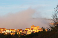 Magrie Village with church. Limoux. Languedoc. An early winter morning with mist still laying low and sunshine glowing golden. France. Europe.