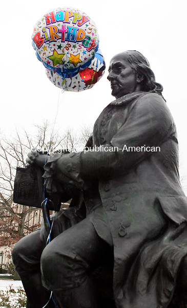 WATERBURY, CT17 January 2006-011706TK06 (left to right:) The statue of Ben Franklin located in front of Waterbury's Silas Bronson Library, was decorated with birthday balloons in celebration of Ben Franklin's birthday.   Tom Kabelka / Republican-American (statue of Ben Franklin)CQ