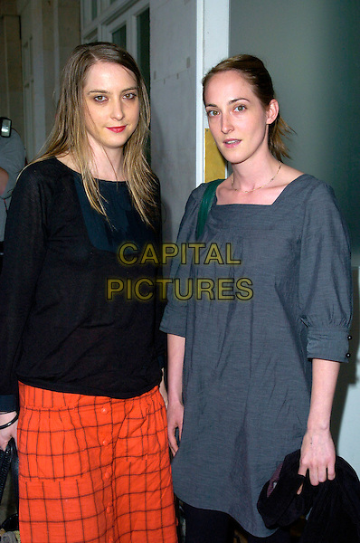 DAISY & POPPY DE VILLENEUVE.The Marks and Spencer Autumn / Winter previews 2007 at The Piazza Covent Garden, London, England..May 24th, 2007.m&s M & S half length black grey gray smock red skirt black top leggings.CAP/CAN.©Can Nguyen/Capital Pictures
