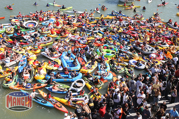 SAN FRANCISCO - JULY 9: Fans gather in boats in McCovey Cove during the home run derby during the All Star Game festivities at AT&T Park in San Francisco, California on July 9, 2007. Photo by Brad Mangin
