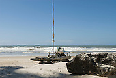 Bahia State, Brazil. Serra Grande beach (Praia da Pe, Pe de Serra Grande). Jangada fishing raft with sail on the beach.