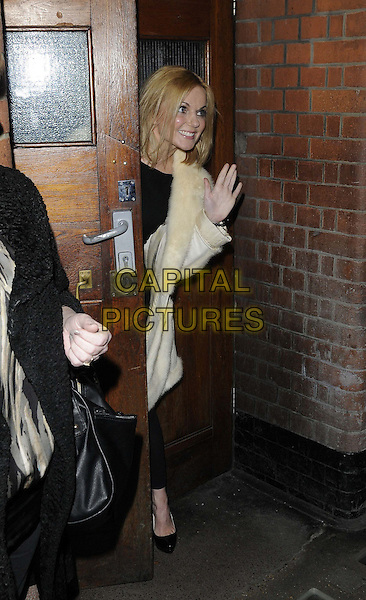 "Geri Halliwell.performed for one night only in the ""Singin' in the Rain"" as part of the POP Goes The Musical Children In Need initiative, Palace Theatre, Shaftesbury Avenue, London, England..October 25th, 2012.full length black white cream fur coat jacket door hand palm waving.CAP/CAN.©Can Nguyen/Capital Pictures."