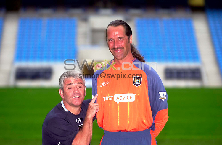 Pix:BEN DUFFY/SWpix.com....Premiership Football....Manchester City at their new ground, 'The City of Manchester stadium'....10/07/2003...COPYRIGHT PICTURE>>SIMONWILKINSON>>01943 436649>>..Manchester City boss, Kevin Keegan shows off his new signing, that of David Seaman from Arsenal.