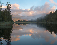 Lake Matheson sunset reflections, Westland Tai Poutini National Park, UNESCO World Heritage Area, West Coast, New Zealand, NZ