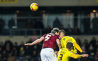 Zander Diamond of Northampton Town & Kemar Roofe of Oxford United clash heads during the Sky Bet League 2 match between Oxford United and Northampton Town at the Kassam Stadium, Oxford, England on 16 February 2016. Photo by Andy Rowland.