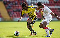 Jerome Sinclair of Watford shields the ball during the Pre Season Friendly match between Woking and Watford at the Kingfield Stadium, Woking, England on 10 July 2016. Photo by Andy Rowland.