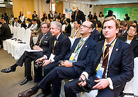 Attendants listen during Bloomberg Forum 'Green Evolution: China and the Global New Energy Race', at the USA Pavilion, in Shanghai World Expo 2010, China, on October 21, 2010. Photo by Lucas Schifres/Pictobank