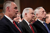 WASHINGTON, DC - JANUARY 30:  (L-R) Secretary of the Interior Ryan Zinke, U.S. Attoney General Jeff Sessions, and U.S. Secretary of Defense Jim Mattis watch during the State of the Union address in the chamber of the U.S. House of Representatives January 30, 2018 in Washington, DC. This is the first State of the Union address given by U.S. President Donald Trump and his second joint-session address to Congress.  <br /> Credit: Win McNamee / Pool via CNP