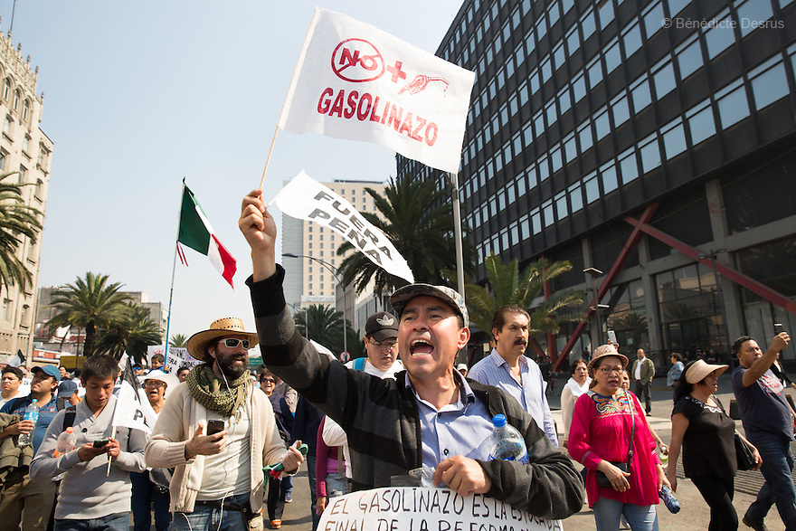 Thousands of demonstrators march to protest a sudden 20 percent fuel price hike imposed by the Mexican government in Mexico City, Mexico on January 7, 2017. The gasolinazo – as the price hike is known – took effect on January 1. The Mexican central bank has warned that gas price increases would likely contribute to inflation at a time when the peso has already weakened significantly against the US dollar. Photo by Bénédicte Desrus