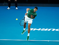 2nd February 2020; Melbourne Park, Melbourne, Victoria, Australia; Australian Open Tennis, Mens singles final on Day 14; Novak Djokovic of Serbia serves during his singles final match against Dominic Thiem of Austria