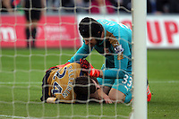 Hector Bellerin of Arsenal is injured on the ground, seen to by team mate Petr Cech during the Barclays Premier League match between Swansea City and Arsenal at the Liberty Stadium, Swansea on October 31st 2015
