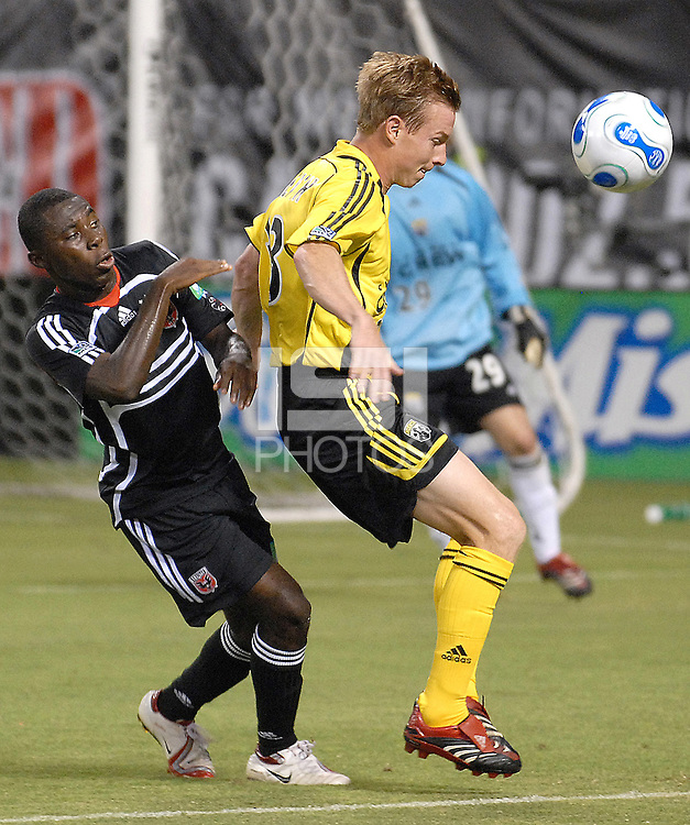 Columbus Crew defender Chris Leitch (33)  fighting for control of the ball and being challenged by midfiedler from DC United Freddy Adu (9) during the game. DC United defeated the Columbus Crew 3-2, Saturday, July 15, 2006.