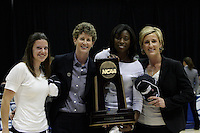 BERKELEY, CA - MARCH 30: Sara Boruta, associate head coach Amy Tucker, assistant coach Bobbie Kelsey, assistant coach Kate Paye pose with the regional champions trophy following Stanford's 74-53 win against the Iowa State Cyclones on March 30, 2009 at Haas Pavilion in Berkeley, California.