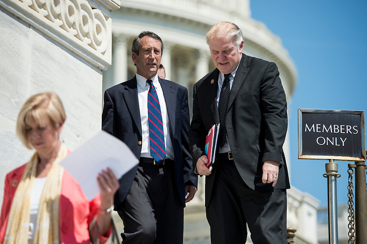 UNITED STATES - MAY 17: Rep. Mark Sanford, R-S.C., left, speaks with Rep. Steve Chabot, R-Ohio, as they walk down the House steps after a series of votes in the House of Representatives on Friday, May 17, 2013. (Photo By Bill Clark/CQ Roll Call)