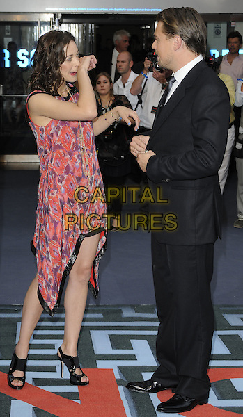 MARION COTILLARD & LEONARDO DICAPRIO .At the World Premiere of 'Inception' at the Odeon Leicester Square cinema, Leicester Square, London, England, .UK, July 8th 2010..arrivals full length red print dress scarf sleeveless black trim purple patterned pattern open toe sandals asymmetric suit tie white shirt hand side funny touching nose wiping  leo di caprio .CAP/CAN.©Can Nguyen/Capital Pictures.