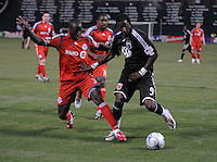 DC United forward Ange N'Silu (9) fights for possession of the ball against Toronto FC defender Nana Attakora-Gyan (3).   DC United tied Toronto FC. 3-3 at  RFK Stadium, Saturday May 9, 2009.