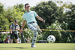 Xing Aowei kicks a football at the 14th hole during the World Celebrity Pro-Am 2016 Mission Hills China Golf Tournament on 22 October 2016, in Haikou, China. Photo by Weixiang Lim / Power Sport Images