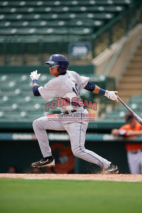 GCL Rays second baseman Jonathan Aranda (10) follows through on a swing during a game against the GCL Orioles on July 21, 2017 at Ed Smith Stadium in Sarasota, Florida.  GCL Orioles defeated the GCL Rays 9-0.  (Mike Janes/Four Seam Images)