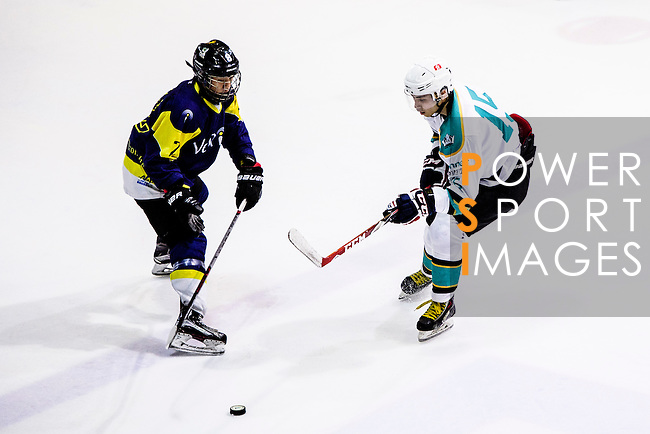 Medical Kings Defense #15 Ying Yeung (r) fights for the puck with Verity Forward #2 Lokel Wong (l) during the Principal Standard League match between Medical Winner Kings vs Verity at the Mega Ice on 17 January 2017 in Hong Kong, China. Photo by Marcio Rodrigo Machado / Power Sport Images