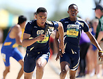 FARGO, ND - MAY 13: D'Khari Hicks from Oral Roberts takes the baton for his leg of the men's 4x400 meter relay Saturday at the 2017 Summit League Outdoor Track Championship at the Ellig Sports Complex in Fargo, ND. (Photo by Dave Eggen/Inertia)