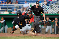 Batavia Muckdogs catcher Igor Baez (29) looks to tag Raul Siri (12) as he slides into home plate in front of home plate umpire Tyler Witte during a game against the West Virginia Black Bears on June 19, 2018 at Dwyer Stadium in Batavia, New York.  West Virginia defeated Batavia 7-6.  (Mike Janes/Four Seam Images)