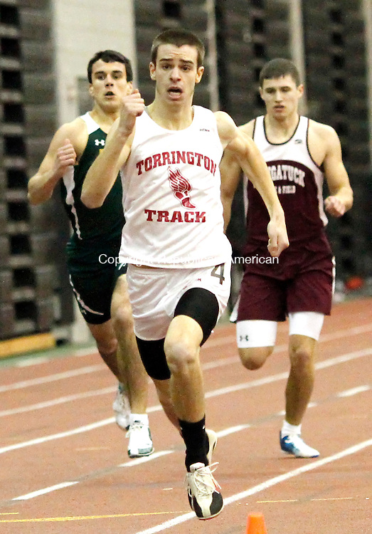 New Haven, CT- 09, February 2011-020911CM06 Torrington's Dylan Kruppa, sprints across the finish line during the 600m race during the NVL Track and Field Championships Wednesday afternoon in New Haven. Kruppa took first in the event.  Christopher Massa Republican-American