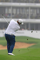 George Coetzee (RSA) plays his 2nd shot on the 18th hole during Saturay's Round 3 of the 2014 BMW Masters held at Lake Malaren, Shanghai, China. 1st November 2014.<br /> Picture: Eoin Clarke www.golffile.ie